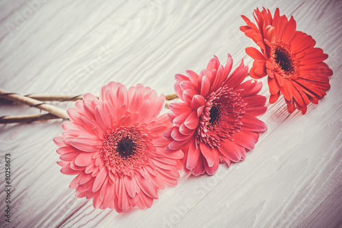 Foto op Aluminium Gerbera colorful gerbera flowers on the wooden table