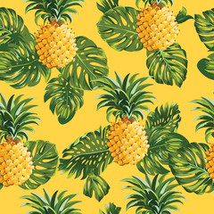 FototapetaPinapples and Tropical Leaves Background