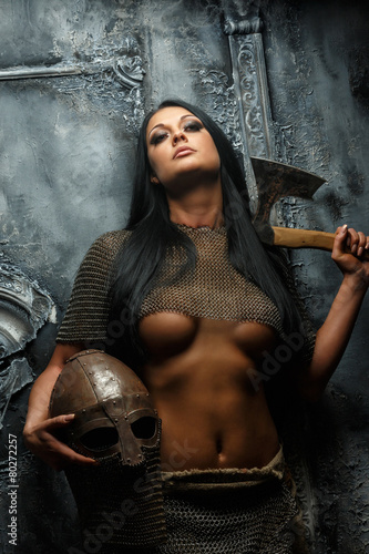 Beautiful female in ancient armor Poster