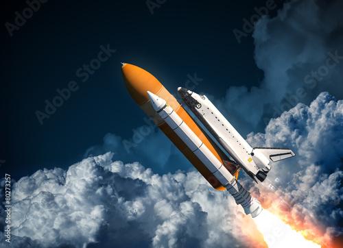 Fototapeta Space Shuttle Flying In The Clouds obraz na płótnie