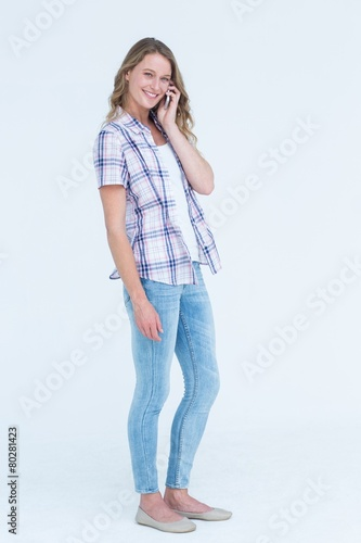 Pretty hipster calling with her smartphone Poster