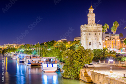 Seville, Spain at the Torre de Oro on the Guadalquivir River.