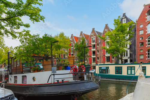 Amsterdam canal with picturesque houseboats, Holland Canvas Print