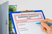 Clipboard With Emergency Evacuation Plan Beside Exit Door