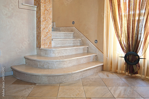 beatutful interior staircase with marble