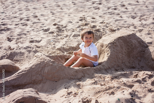 Fotografie, Obraz  Adorable kid, playing on the beach