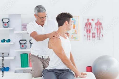 Canvas Print Doctor doing back adjustment