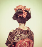 Backside of Japanese traditional doll of dancing Geisha with whi