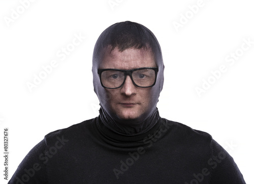 Fototapety, obrazy: Thief in balaclava making funny faces, dressed in black.