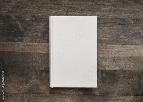 Fototapeta Book. Photo blank book cover on textured wood background obraz