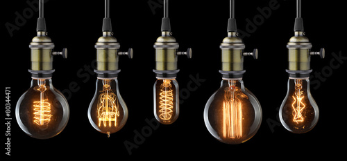 Foto op Plexiglas Retro Set of vintage glowing light bulbs on black