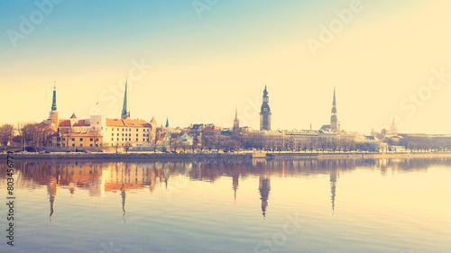 Obraz na plátně Riga center with reflection in Daugava, with retro filter effect