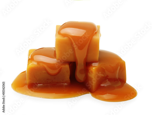 Fotomural  Caramel toffee and sauce isolated