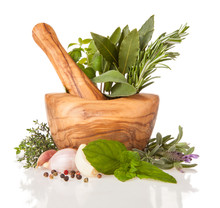 Wooden Mortar With Herbs On Wh...