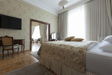 King Size Bed With Pillows In Luxury Apartment