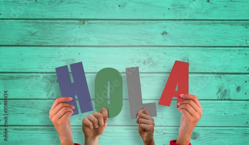 Composite image of hands holding up hola Wallpaper Mural