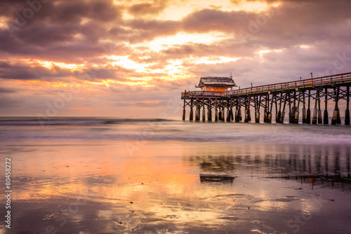 Cocoa Beach, Florida, USA beach and pier at sunrise.