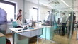 Time lapse of attractive young professionals at work in busy modern office
