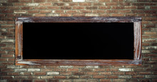 Blank Vintage Chalk Board On Brick Wall Background