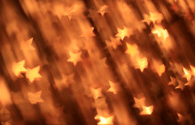 Festive Gold Background With Star-shaped Bokeh
