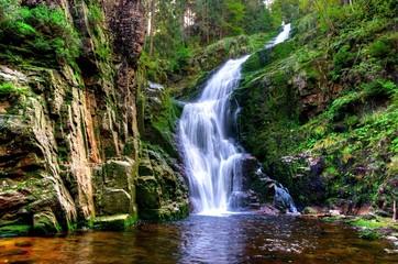 Waterfall in mountains. Kamienczyk Karkonosze, Poland