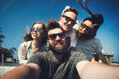Obraz Multiracial friends make selfie in Phuket Thailand while travel - fototapety do salonu