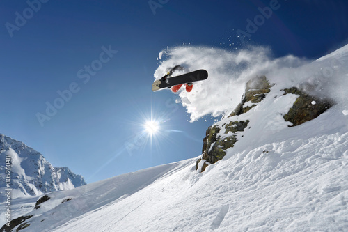 "Photo Snowboarder pulls off a ""Method Air"" in the backcountry"