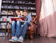 Sweet Lovers Reading a Book at the Library
