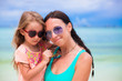 Hppy family of mom and girl during summer beach vacation