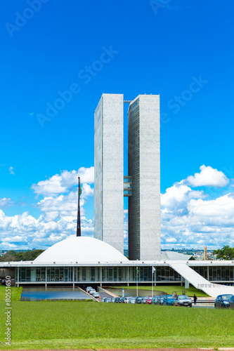 Fotografie, Obraz  Brazilian waving flag on blue sky