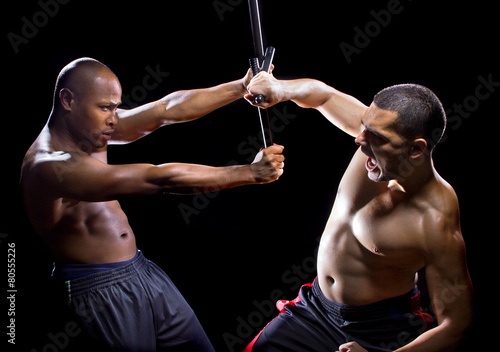 Photo sur Toile Gymnastique two men sparring with Filipino stick fighting martial arts