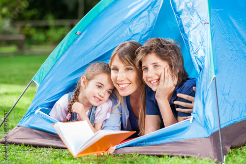 Poster Camping Children With Mother Holding Book In Tent