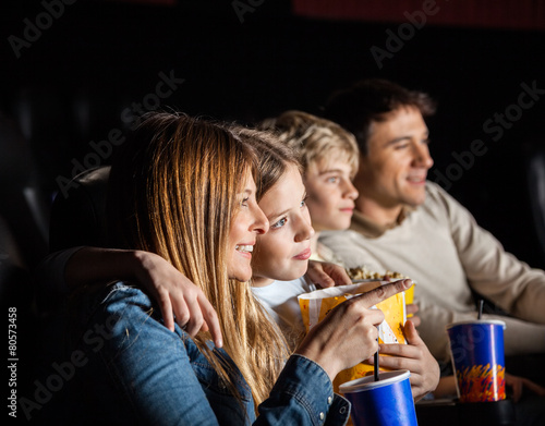 Family Of Four Watching Movie In Theater