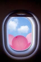 Clouds And Pink Balloons In The Aircraft's Porthole