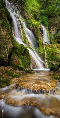 Beautiful waterfall among cliffs in spring time © Jess_Ivanova