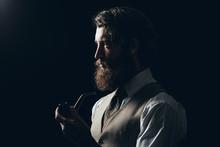 Silhouette Man With Beard Holding Smoking Pipe