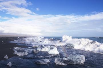 Ice blocks on a black sand beach near Jokulsarlon, Iceland