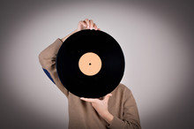 Young Boy Holding A Vinyl Record
