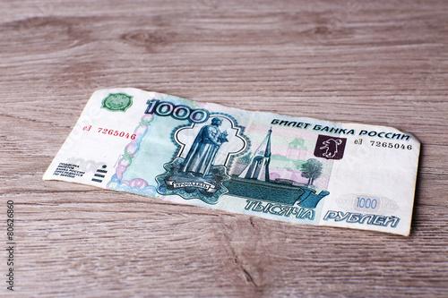 Fotografía  One denomination on wooden background
