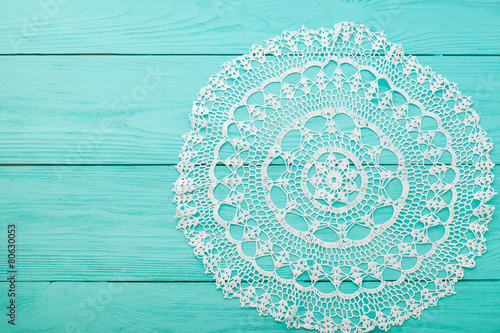 Fotografia, Obraz  Lace doily on wooden background