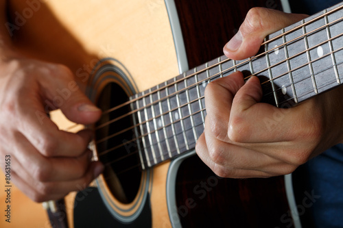 Acoustic guitar player performing song Fototapeta
