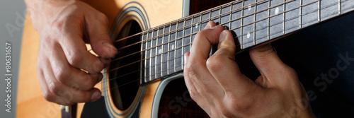 Fototapeta Acoustic guitar player performing song