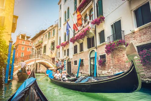 Foto op Plexiglas Venetie Gondolas on canal in Venice, Italy with retro vintage filter
