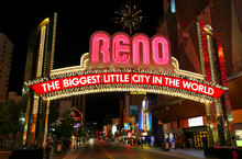 """Famous """"The Biggest Little City In The World"""" Sign At Night In R"""
