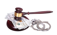 Judge Gavel And Handcuffs With Money Isolated On White Backgrou
