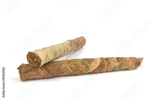 Handmade cigars on white with selective focus - Buy this