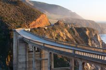 Arch Bridge On Winding Coastal Highway