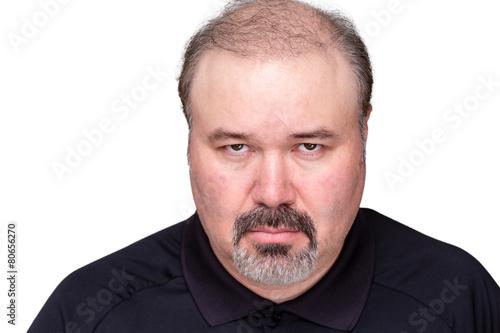 Valokuva  Dour angry man glowering at the camera
