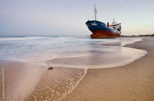 Fotobehang Schipbreuk Wrecked ship ashored in Sharjah - Ajman beach