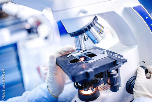 Obraz na plátně Details of medical laboratory, scientist hands using microscope